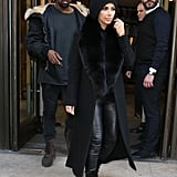 Kim Bundled Up For the Cold in a Fur-Collared Coat and Slouchy Black Beanie