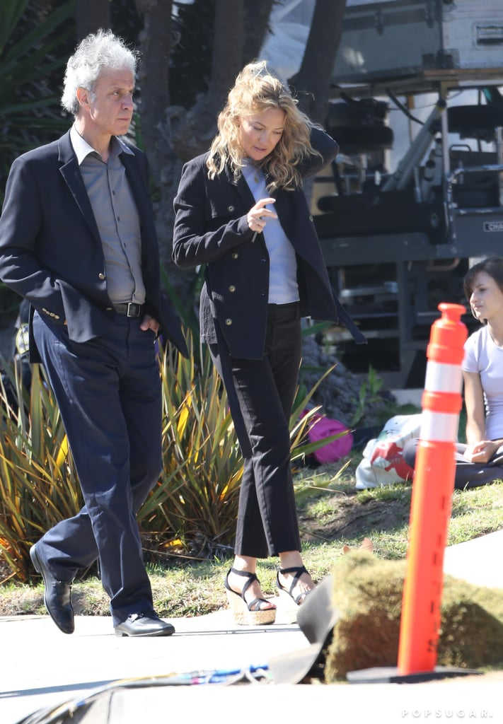 Kate Hudson wore a blue suit on set.