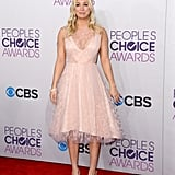 Host Kaley Cuoco chose a blush dress.