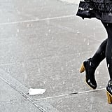 There's nothing better suited for inclement weather than a pair of quintessential black boots with a substantial heel.