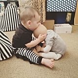 """We couldn't stop laughing at Bill Horn's assessment of his youngest's interaction with his doll: """"Boz is either trying to eat or kiss Baby Lille."""""""