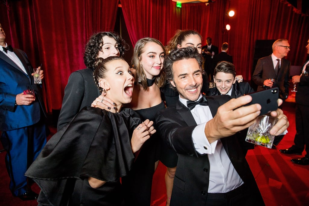 Millie Bobby Brown, Finn Wolfhard, Shawn Levy, and Noah Schnapp gathered for a fun picture at a Golden Globes afterparty in 2018.