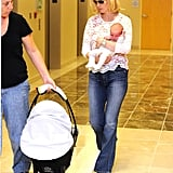 January Jones carries baby Xander.