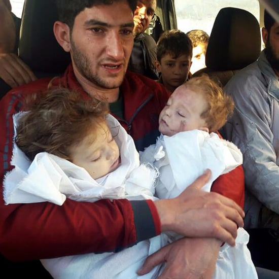 Syrian Dad Holds Dead Twins After Gas Attack