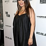 Mila dressed her baby bump in a black frock.