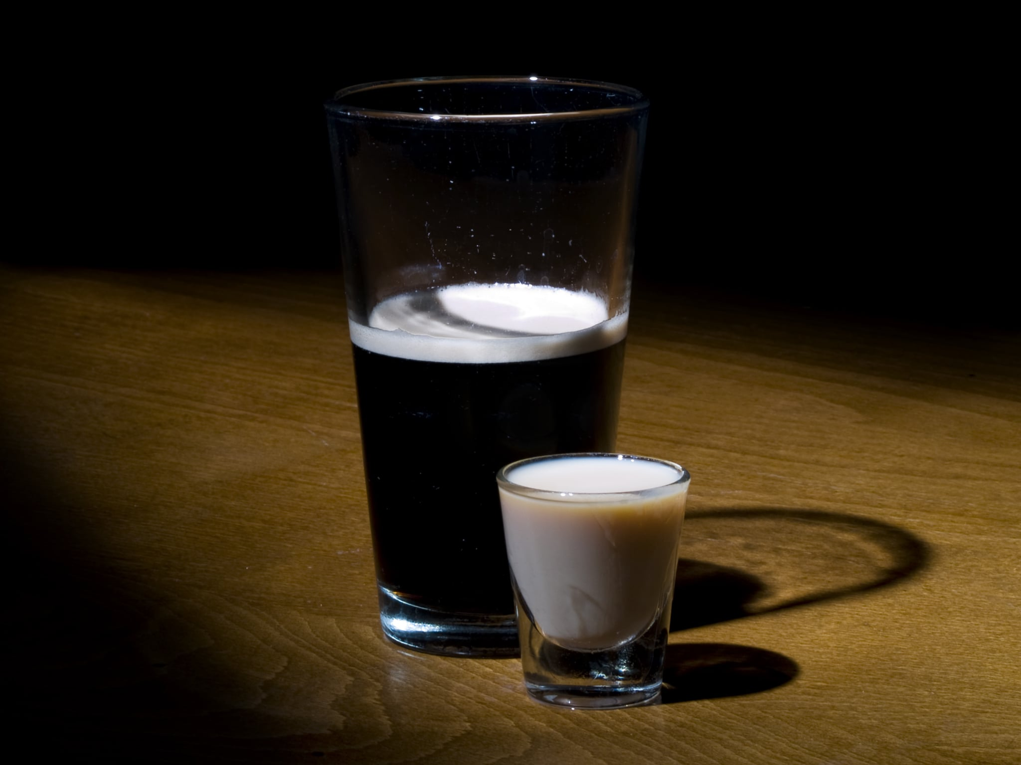 A popular Irish drink, the Irish Car Bomb.  A glass of Guinness beer and a shot of irish cream.