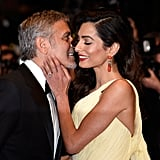 She Showed Off Her Stunning Drop Earrings as George Whispered in Her Ear