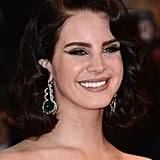 Lana Del Rey wore large Chopard earrings.