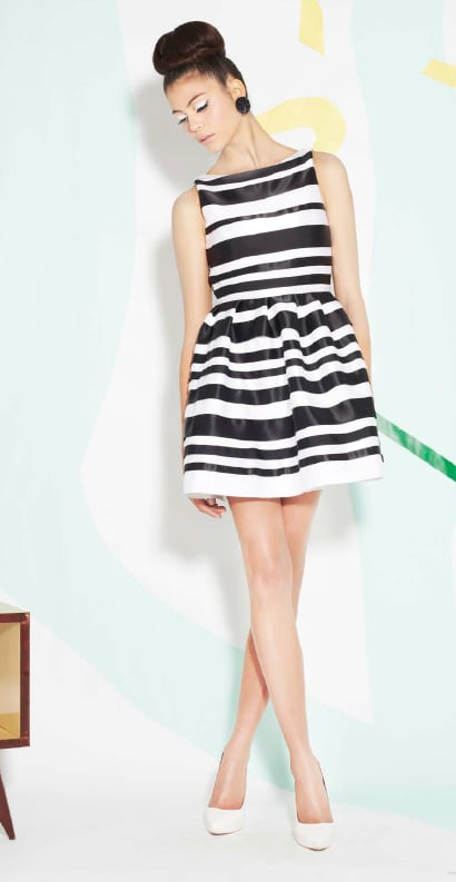 We adore the fit-and-flare look of this black-and-white striped dress and that it's styled with on-trend white pumps.