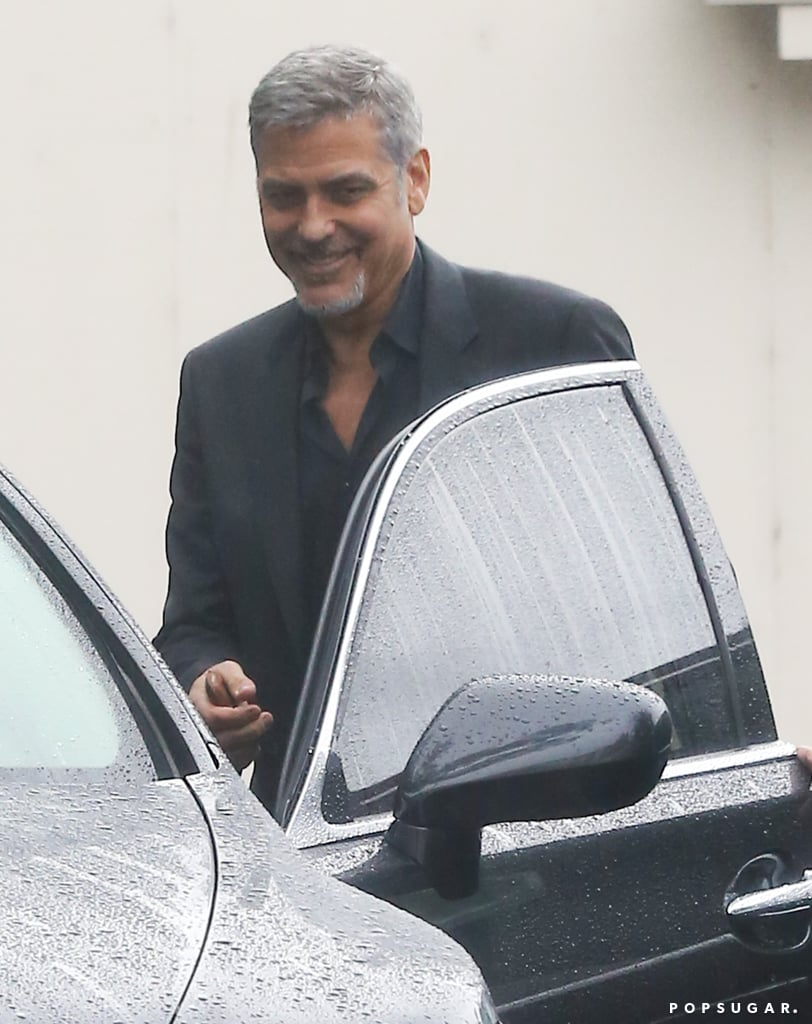 """Just days after criticizing Hello magazine for publishing a """"completely fabricated"""" interview about his wife, Amal, George Clooney was spotted out in LA looking as happy as ever on Friday. The actor, who will be ringing in his 55th birthday next month, flashed a sweet smile and his signature sexy squint while exiting his car. At one point, he stopped to greet a man on his way to an office building, where his Money Monster costar Julia Roberts and director Jodie Foster were also headed. In the film, George plays Lee Gates, a Wall Street newsman who gets held hostage after he wrongly advises an investor. Keep reading to see more of George, then check out the trailer for the film before it hits theaters on May 13."""