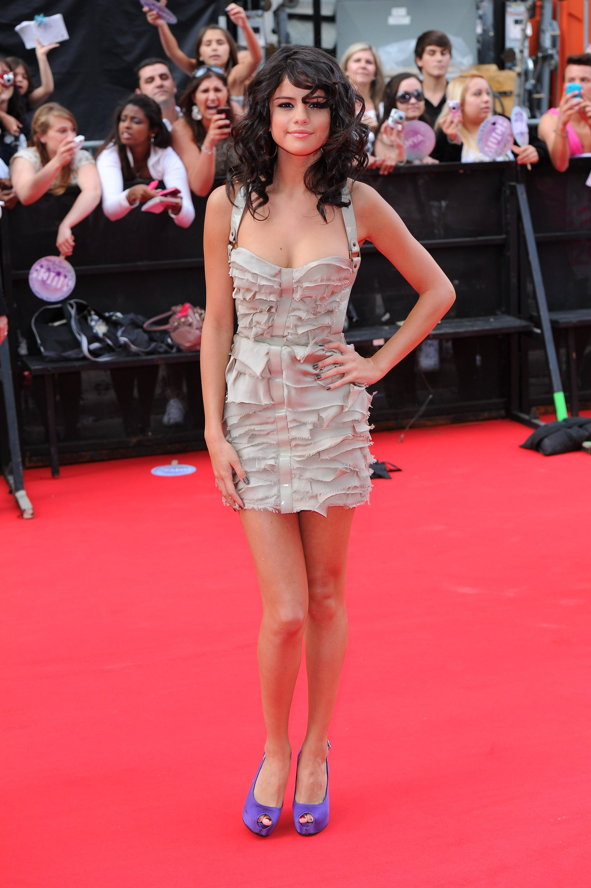 Selena opted for a tiered, ruffled Burberry dress and purple heels at the MuchMusic Video Awards in 2011.