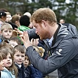 Prince Harry Turns On the Charm For Kids, Soldiers, and Flood Victims in England