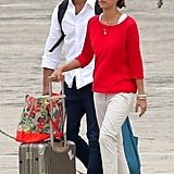 Looking crisp and tan, Jessica and Cash traveled back home from St. Barts. For the flight, Jessica paired a bright red sweater with cropped khaki trousers,  then accessorized via matching red-and-white striped wedges, tortoiseshell sunglasses, her Tory Burch hat, and a few bangles. Do the same, then add these similar Rocket Dog striped sandals ($40) to complete your look.