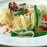When it's hot outside, one of the easiest ways to cool down (and rev up your metabolism) is by getting spicy. A Thai classic, this recipe for green papaya salad is refreshing, crisp, and full of flavor. Source: Flickr user Maggie Hoffman