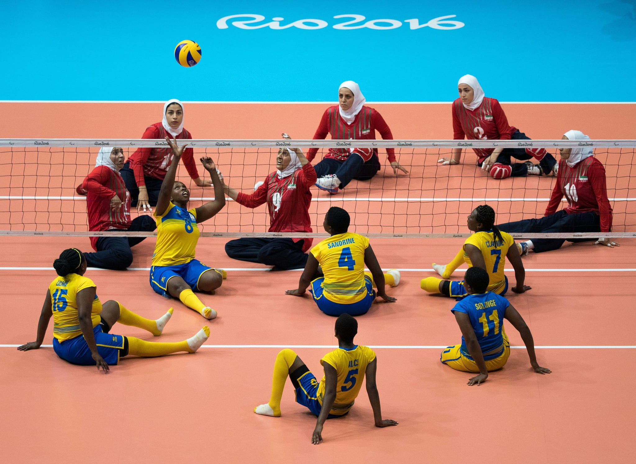 Rwanda (front) plays Iran in a Sitting Volleyball Women's Preliminaries Pool B Match for the Paralympic Games, in Rio de Janeiro, Brazil, on September 12, 2016. Photo By Simon Bruty or OIS/IOC via AFP.  RESTRICTED TO EDITORIAL USE.    / AFP / OIS/IOC / Simon Bruty for OIS/IOC        (Photo credit should read SIMON BRUTY FOR OIS/IOC/AFP via Getty Images)