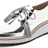 I've been admittedly obsessed with the comforable footwear trend of 2015, and the good news is it's not slowing this year. With these Loeffler Randall Callie Platform Oxfords ($395) on hand, I'll feel polished, without ever needing to pull on my pumps.  — HM