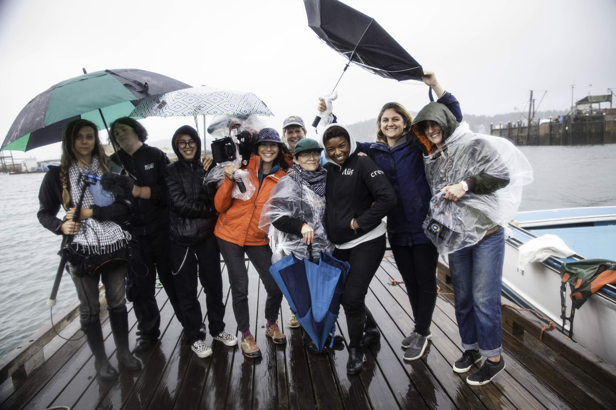STONINGTON, ME 9/3/17 5:49:56 PM The crew with Julie Eaton after filming on her lobster boat in Stonington, Maine, on Sunday, September 3, 2017.  From left, Taylor Roy, Melissa McCollum, Emma Appel, Jenni Morello, Julie Eaton (back, lobster boat captain), Ana Veselic, Christine Wairegi, Alexandra Nikolchev and Jessica Chermayeff.  Photo by Sarah Rice