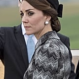 To commemorate the Battle of the Somme, Kate wore faux pearl and crystal costume jewelry earrings from Balenciaga, costing $745.