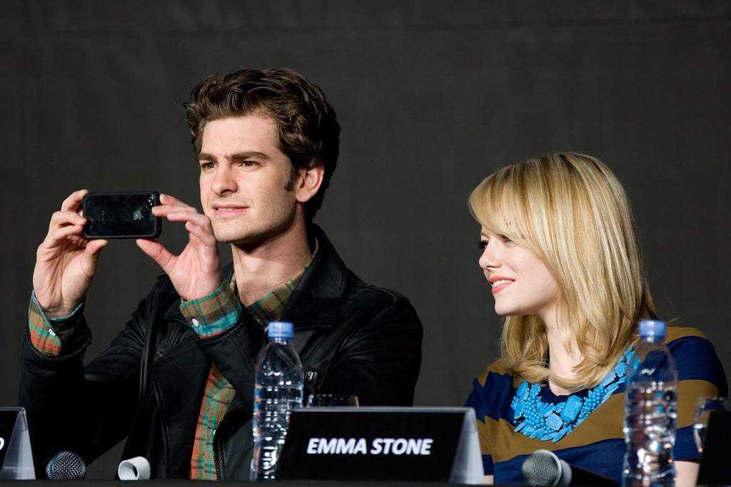 Andrew Garfield had his iPhone out with Emma Stone at a press conference for The Amazing Spider-Man in Seoul.