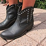 Black leather booties — along with the requisite silver studs — bring serious heat.