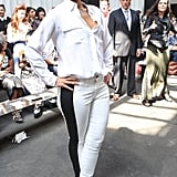 Alicia Keys punched up an all-white outfit at Edun with a bold black racing-stripe-style jean in NYC.