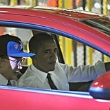 Riding with South Korean President Lee Myung-Bak at a General Motors factory in 2011.
