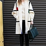 The window-pane print on this creamy coat gave it preppy flair; while metallic pink loafers provided a punky finish.