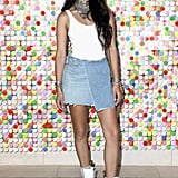 Shanina Shaik wore a white bodysuit by House of Harlow 1960 and a Grlfrnd Denim skirt at #REVOLVEfestival.