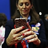 An attendee used her phone in the convention.