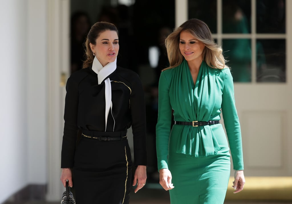 Days after Melania Trump raised some eyebrows with her official White House portrait, she stepped out to meet Queen Rania of Jordan in a more demure dress. Melania chose a structured emerald number with long sleeves while its hem, with a middle slit, hit at the knees. As she walked side by side with Queen Rania through the White House grounds, we noticed that the two actually (sort of) wore the same outfit.  They both opted for a skinny belt to cinch in their dresses and wore classic closed-toe pumps. Though Melania wore black heels to match her waist accessory, Queen Rania took a bolder route with white pumps to match her dress's collar. Her ensemble was as sophisticated as it gets, something we've come to expect from the royal. While the two ladies talked confidential business, their outfits spoke volumes all on their own. Scroll to have a look at these power women essentials, then shop some of your own.      Related:                                                                                                           Does Melania Trump Have What It Takes to Master First Lady Style?