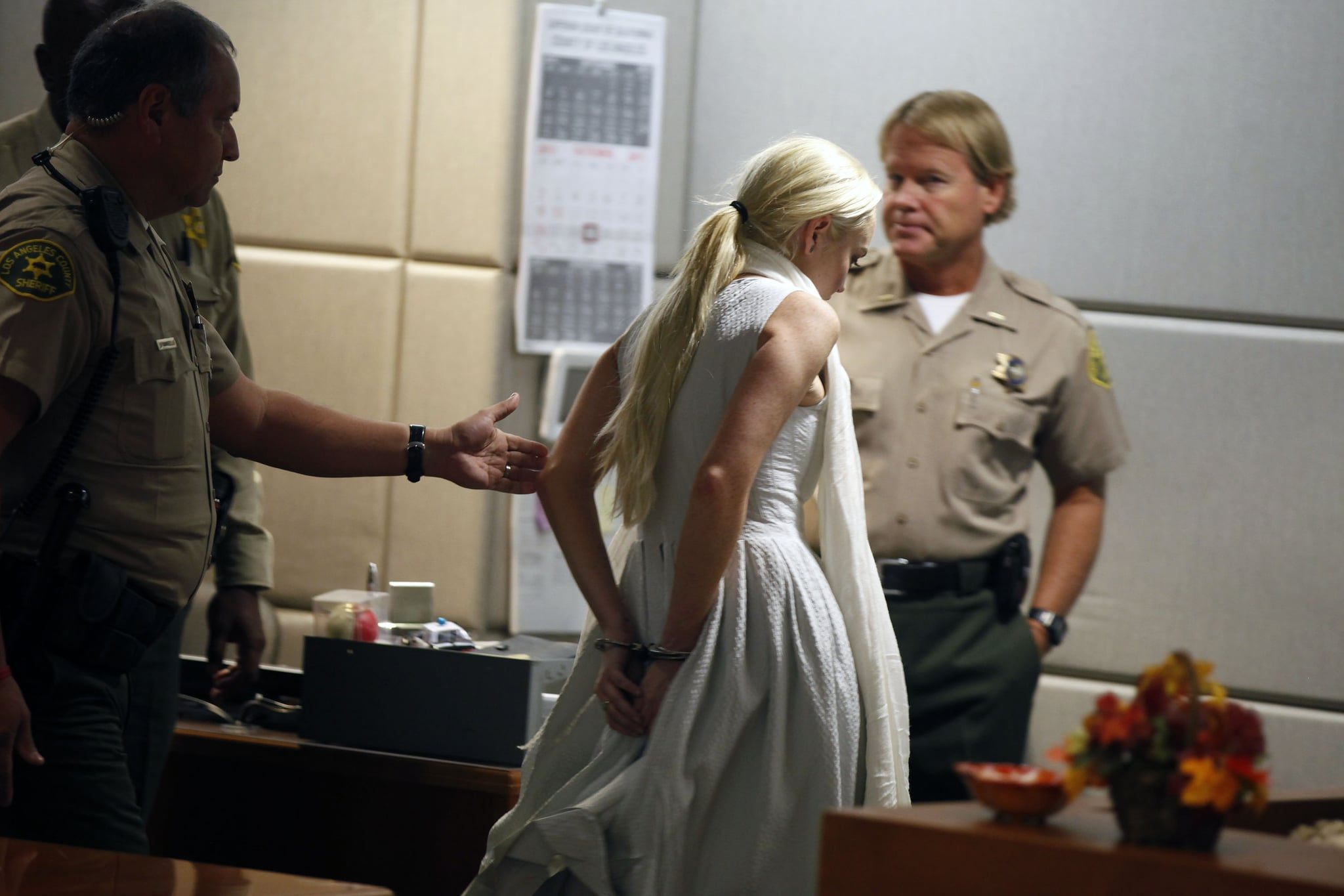Lindsay Lohan was escorted out of an LA courthouse in handcuffs.
