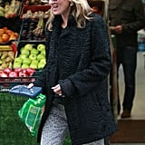 Kate Moss had a smile on her face as she walked out of the store.