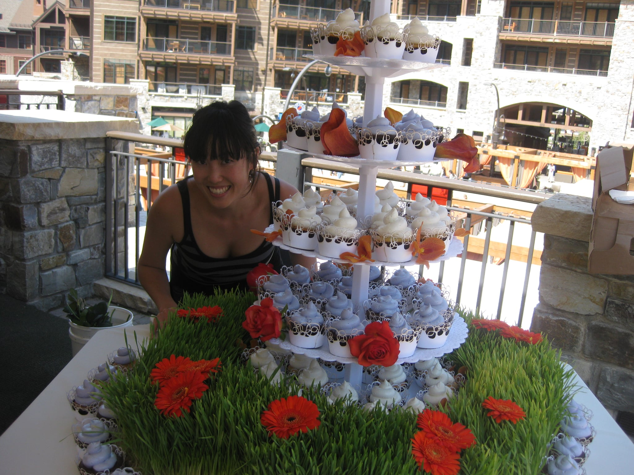 Grace poses with the cupcakes.