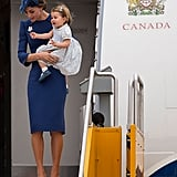 Kate touched down in Canada looking impeccably polished in a blue sheath dress and coordinating fascinator.