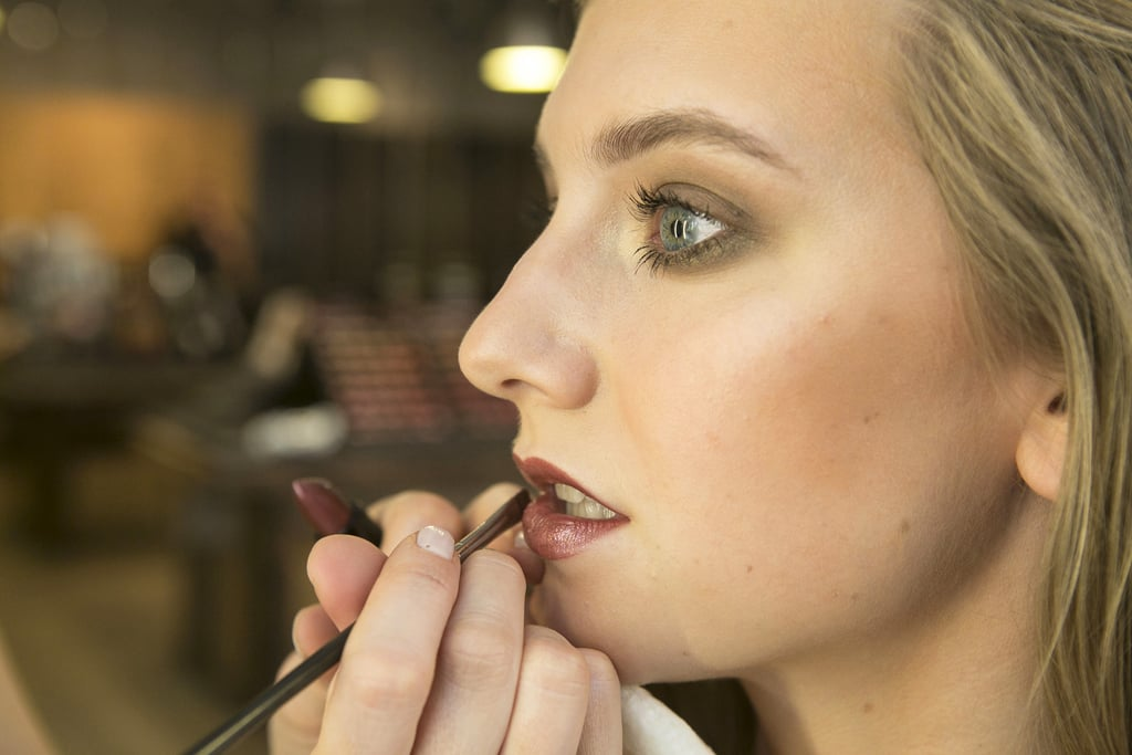 "To bring your look into the evening, add a shimmering violet lip color like Temperature Rising Lipstick in Caliente ($17). ""For night, I like to use something with shimmer so the light bounces off it,"" Bettelli says."