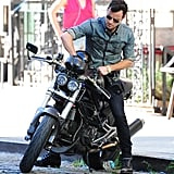 When he played with his motorcycle in the sunshine.