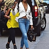 Naomi Campbell took the plunge with a low-cut top and cropped skinny jeans.