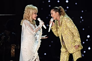 Miley Cyrus Can't Stop Smiling as She Shares the Stage With Her Godmother, Dolly Parton