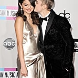 Justin planted a kiss on Selena on the red carpet at the AMAs in 2011.