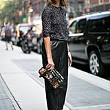 How cool are her Proenza clutch and leather pants?