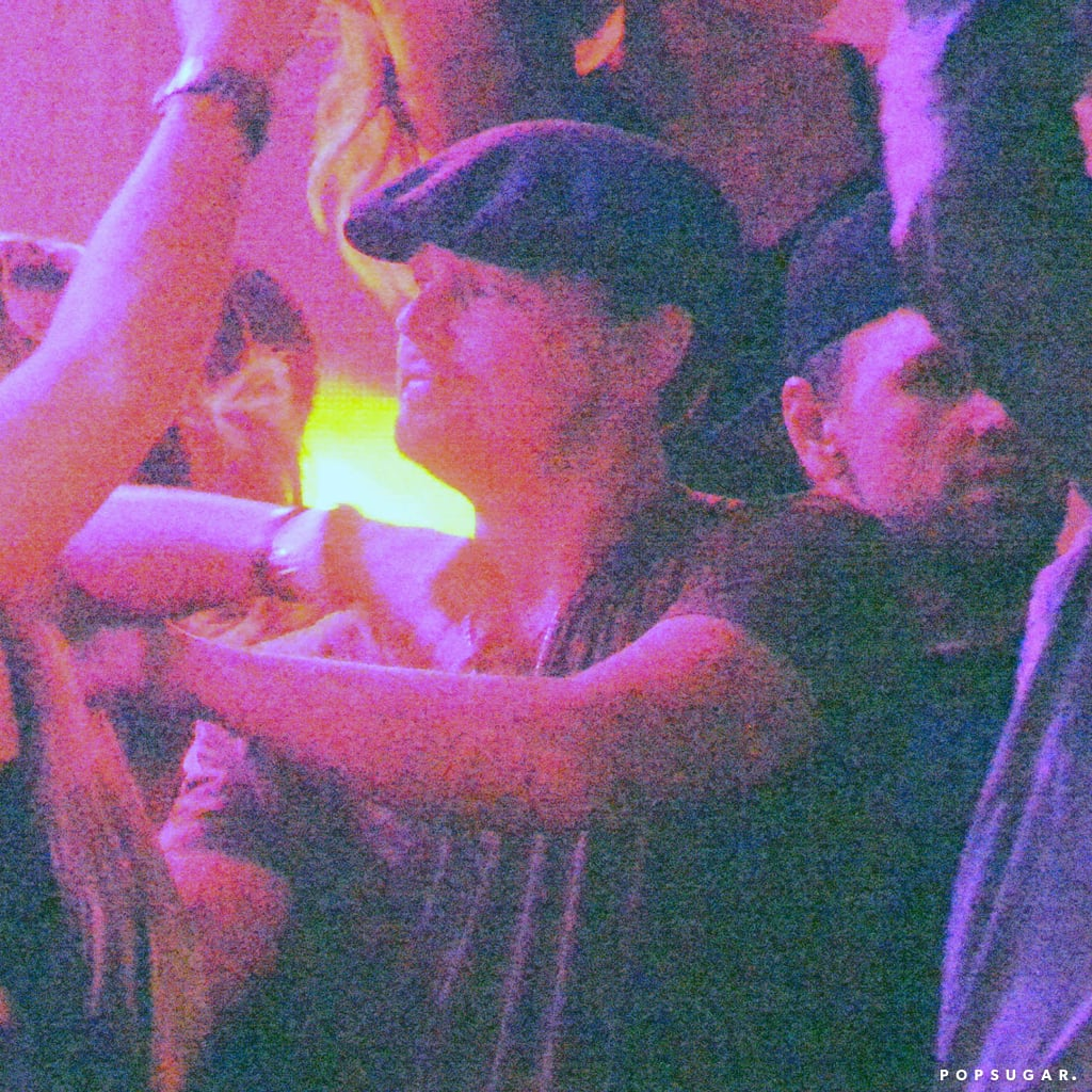 Leonardo DiCaprio kept his hat on in the club.