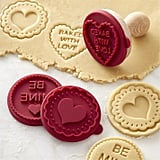 Imagine the kids baking cookies with Mom using this Valentine's Day cookie-cutter stamp set ($13) to customize every sweet bite. Cute!