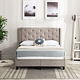 Reinaldo Studded Winged Upholstered Storage Platform Bed