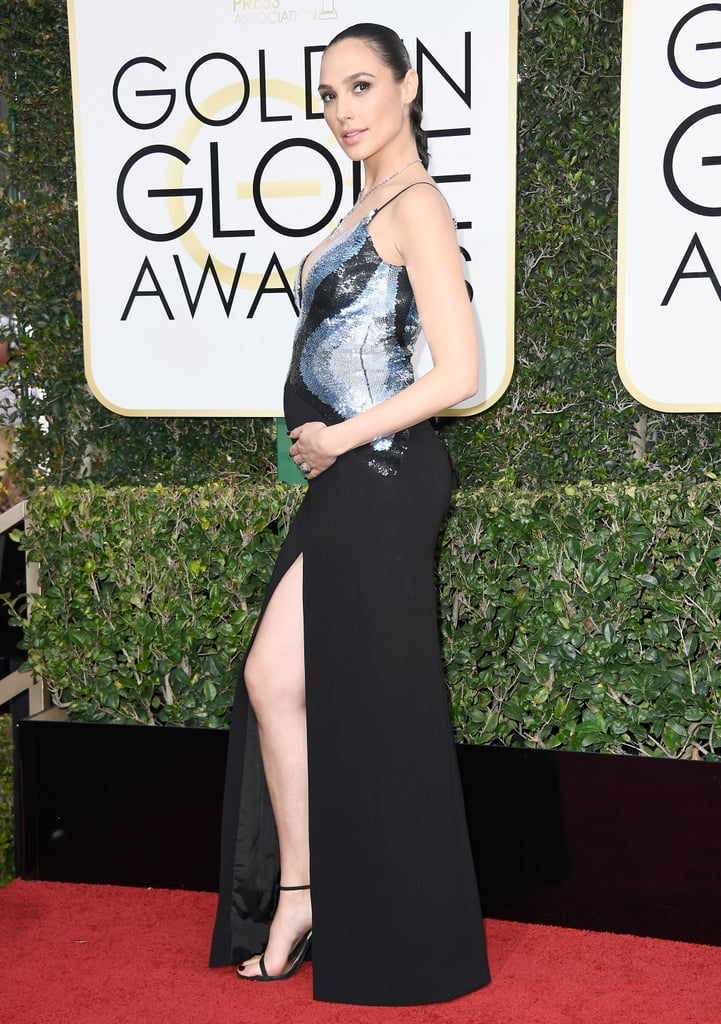 Gal Gadot in a sequined slitted Mugler dress, Stuart Weitzman shoes, and Tiffany & Co. jewels in 2017.