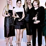Elle Fanning, Emma Watson, Uma Thurman and Shirley Maclaine posed with their awards on stage at the Elle Women in Hollywood Awards.