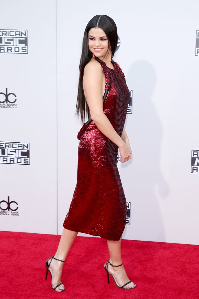 6702359a0831 Selena paired her statement dress with simple strappy Jimmy Choo sandals.