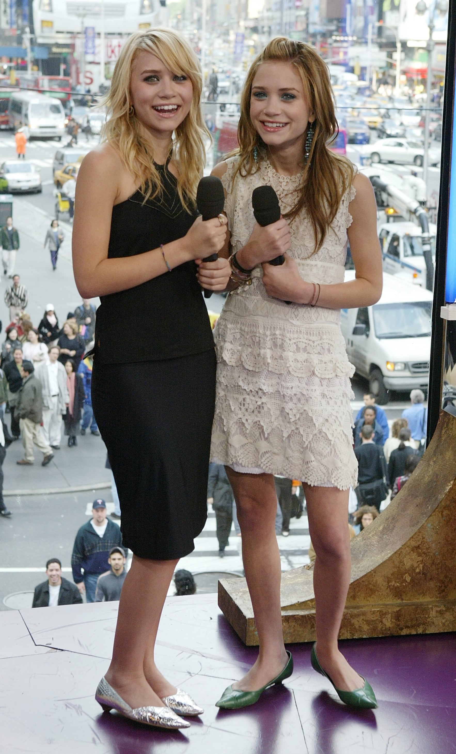 Twinning combo: The girls paired feminine dresses with pointed kitten heels while visiting MTV's TRL studio in May 2004.  Ashley hammed it up in a black body-con halter and silver metallic kitten heels. Mary-Kate  was all smiles in a cream lace sheath and green pointed kitten heels.