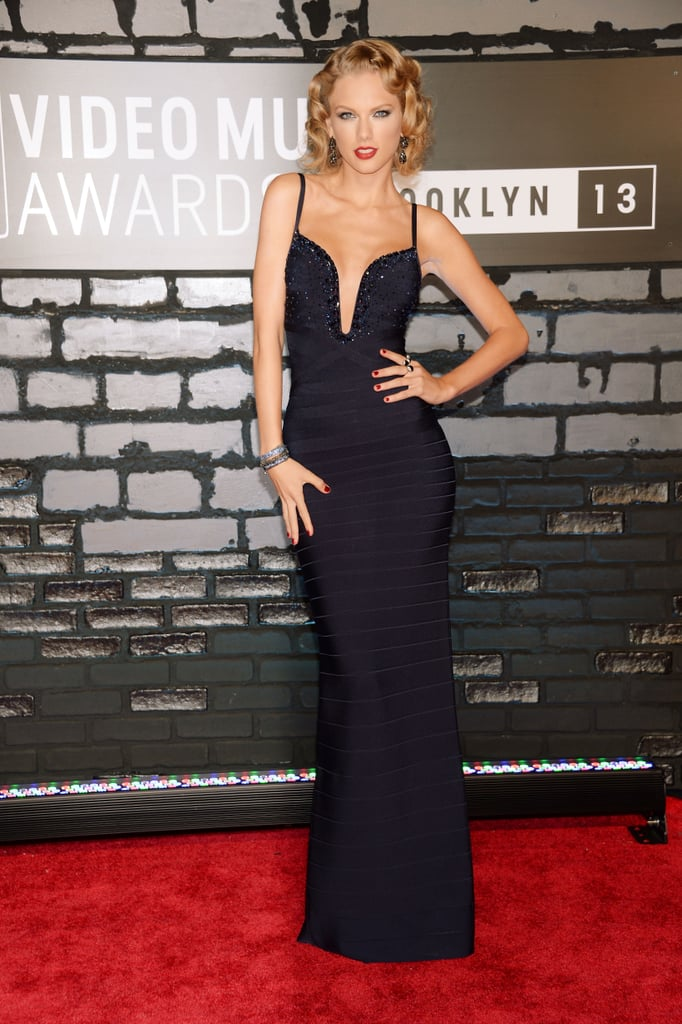 Taylor Swift took the plunge in a navy gown featuring sequins along the bodice. She finished off her glam look with Lorraine Schwartz jewels.