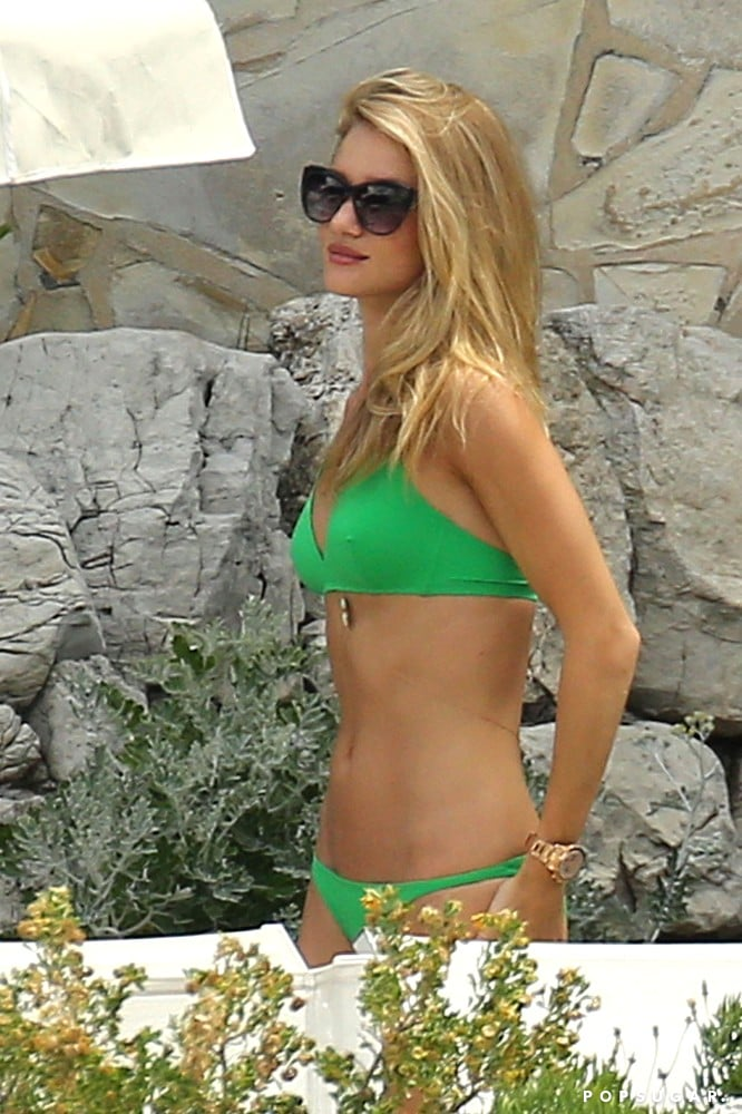 In June, Rosie Hungtington-Whiteley wore a green bikini during a trip to the South of France.