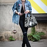 With your distressed black skinnies tucked right into your staple black boots.